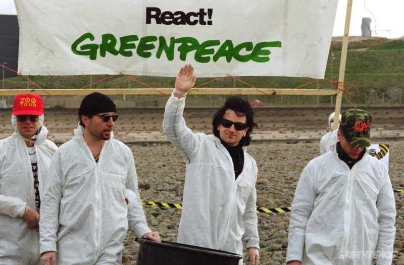 Irish rock band U2 protesting at Sellafield nuclear reprocessing plant in Cumbria with Greenpeace against the new THORP plant due to open in 1992.  THORP will increase radioactive emissions from Sellafield by up to 1000%.  U2 arrived at Sellafield on the SOLO after playing at a 'Stop Sellafield' concert in Manchester.